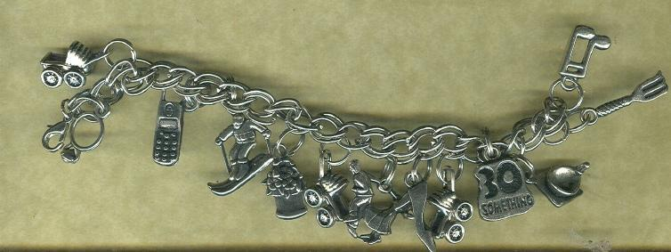 Silver Charm Bracelet w/ 14 Assorted Charms Included