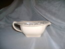 Antique Creamer with Sterling Silver Design
