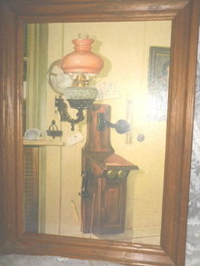 Vintage Picture of Antique Wooden Telephone & Antique Oil Lamp