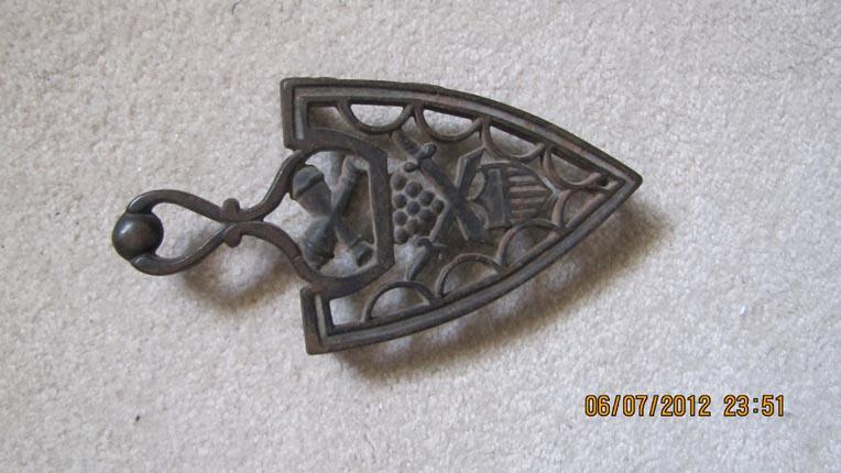Cast Iron Trivet Featuring Militaria