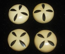 Four Ivoroid Buttons