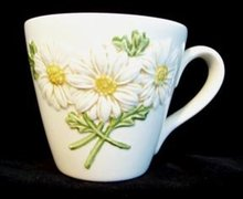 Metlox Poppytrail Sculptured Daisey Cup and Saucer