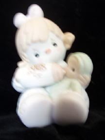 Can't Get Enough of Our Club Precious Moments Figure