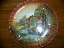 Pair of scenic hand painted plates