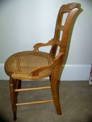 Cane chair with round seat
