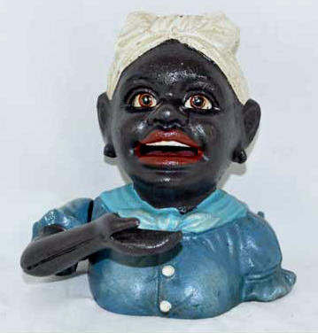 SMALL BLACK GIRL MECHANICAL BANK CAST IRON