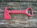 RED AXE BOTTLE OPENER MARKED DIXIE BEER CAST IRON