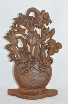 FLOWER BASKET DOORSTOP RUSTIC CAST IRON
