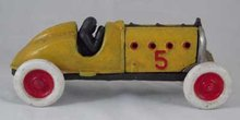 COLORFUL YELLOW RACER CAR CAST IRON HOOD OPENS