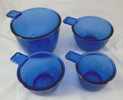 ONE SET FOUR COBALT MEASURING CUPS