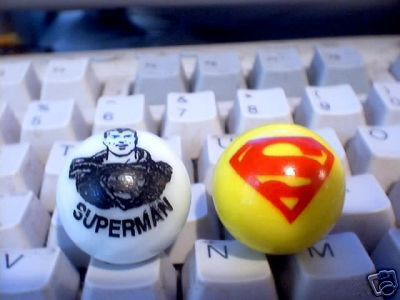 TWO SUPERMAN GLASS LOGO MARBLES