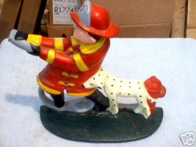 FIREMAN  DALMATION DOORSTOP CAST IRON