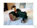 CAST IRON PORKY PIG TRACTOR
