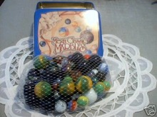MARBLE TIN WITH MARBLES