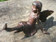 CAST IRON FAIRY HOLDING BIRD