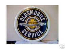 OLDSMOBILE ROUND TIN SIGN