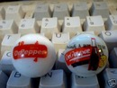 TWO DR. PEPPER LOGO MARBLES