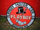 PLAYBOY MOTOR CAR  CO HEAVY METAL SIGN
