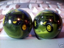 TWO JOHN DEERE MARBLES