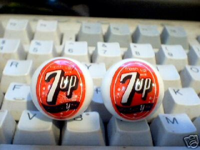 TWO 7 UP MARBLES