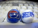 TWO PEPSI POP GLASS MARBLES