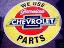 CHEVROLET PARTS TIN SIGN ROUND YELLOW METAL ADV