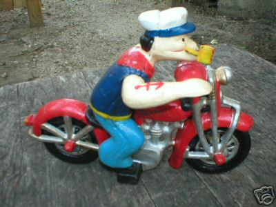 POPEYE WITH PIPE ON MOTORCYCLE CAST IRON