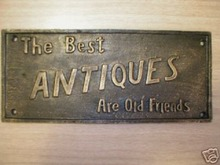 THE BEST ANTIQUES ARE OLD FRIENDS CAST IRON SIGN NR