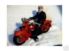 HIPPIE ON A RED MOTORCYCLE CAST IRON COLLECTIBLE