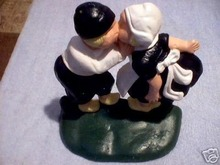 CAST IRON BOY & GIRL KISSING DOORSTOP IOWA COLLECTIBLE