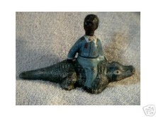 BOY ON ALLIGATOR CAST IRON