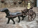 CAST IRON DOG IN TWO-WHEEL CART NR