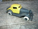 SMALL CAST IRON YELLOW BLACK TOY CAR