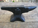 SMALL CAST IRON ANVIL MARKED IHC