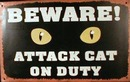 ATTACK CAT ON DUTY TIN METAL SIGN