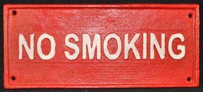 RED NO SMOKING SIGN CAST IRON