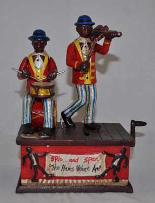 SPIC AND SPAM WIND UP MUSICAL MECHANICAL BANK CAST IRON