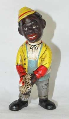 BLACK MAN HOLDING CHICKEN CAST IRON