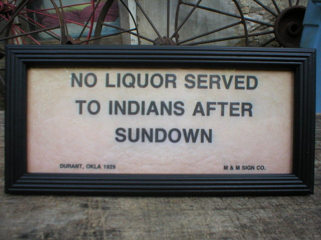 NO LIQUOR SERVED TO INDIANS AFTER SUNDOWN SIGN