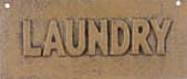 ONE TAN VINTAGE STYLE CAST IRON TAN LAUNDRY SIGN