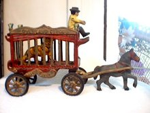 CAST IRON HORSE DRAWN CIRCUS WAGON C