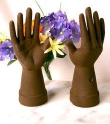 CAST IRON PAINTED RUST HAND RING HOLDER R