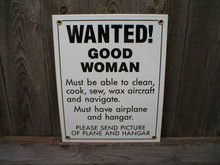 WANTED GOOD WOMAN AIRPLANE PORCELAIN-COATED SIGN T