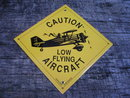 CAUTION LOW FLYING AIRCRAFT PORCELAIN-COATED SIGN O