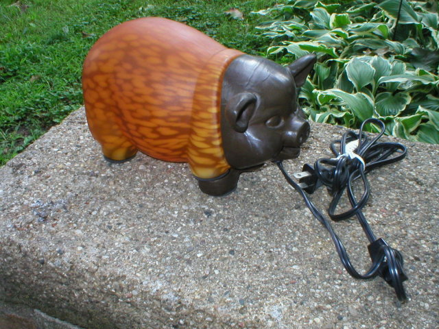 CAST IRON PIG LAMP AMBER GLASS BODY P