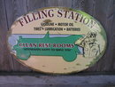 FILLING STATION CLEAN REST ROOMS TIN SIGN