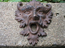 GOTHIC HORNED MAN WALL PLAQUE CAST IRON