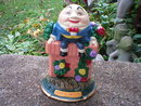 CAST IRON HUMPTY DUMPTY SITTING ON WALL DOORSTOP H