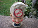 COCA-COLA SPRITE BOY STILL BANK CAST IRON