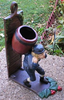 BOY CARRYING BARREL BOOKEND CAST IRON